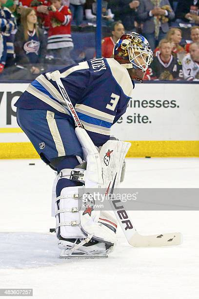 Curtis McElhinney of the Columbus Blue Jackets warms up prior to the start of the game against the Chicago Blackhawks on April 4 2014 at Nationwide...