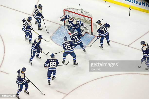 Curtis McElhinney of the Columbus Blue Jackets warms up prior to the start of the game against the Montreal Canadiens on December 23 2016 at...