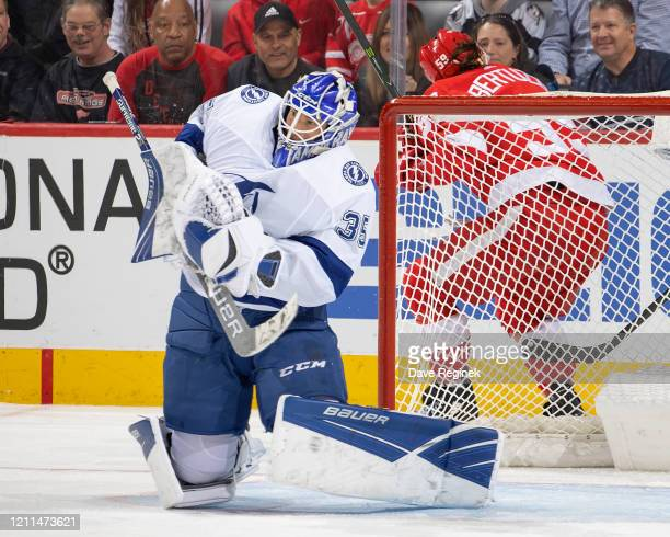 Curtis McElhinney of the Tampa Bay Lightning makes a shoulder save against the Detroit Red Wings during an NHL game at Little Caesars Arena on March...