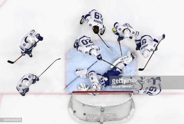 Curtis McElhinney of the Tampa Bay Lightning skates in warm-ups prior to the game against the New York Islanders in Game Six of the NHL Stanley Cup...