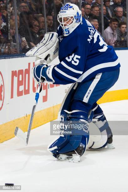 Curtis McElhinney of the Toronto Maple Leafs clears the puck against the Washington Capitals during the first period at the Air Canada Centre on...
