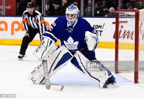 Curtis McElhinney of the Toronto Maple Leafs follows the play against the Columbus Blue Jackets during the second period at the Air Canada Centre on...