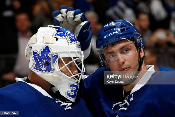 Curtis McElhinney of the Toronto Maple Leafs is congratulated by teammate Tyler Bozak after the Leafs defeated the Dallas Stars at the Air Canada...