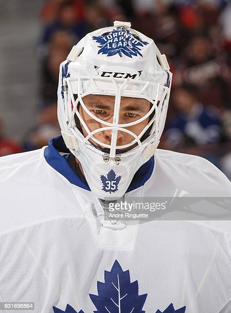 Curtis McElhinney of the Toronto Maple Leafs looks on as he warms up prior to his first start with his new team in a game against the Ottawa Senators...
