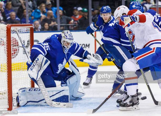 Curtis McElhinney of the Toronto Maple Leafs makes a save against the Montreal Canadiens during the third period at the Air Canada Centre on March 17...