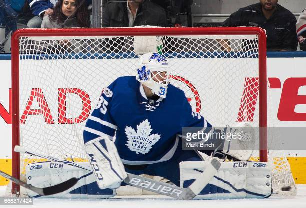 Curtis McElhinney of the Toronto Maple Leafs makes a save on the Pittsburgh Penguins during the third period at the Air Canada Centre on April 8 2017...