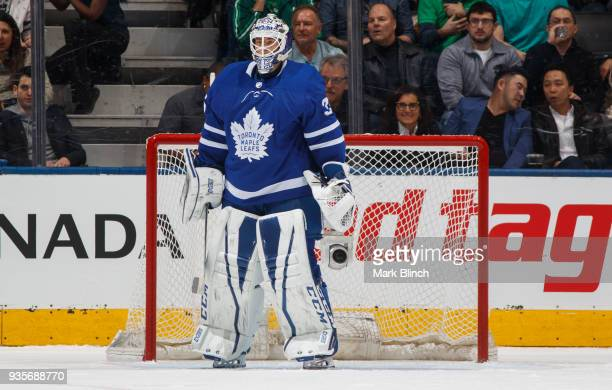 Curtis McElhinney of the Toronto Maple Leafs stands in net against the Montreal Canadiens during the first period at the Air Canada Centre on March...