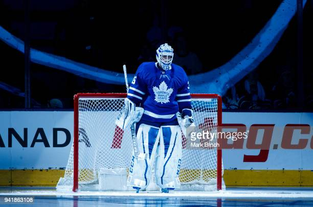 Curtis McElhinney of the Toronto Maple Leafs stands in net during player introductions before playing the Buffalo Sabres at the Air Canada Centre on...