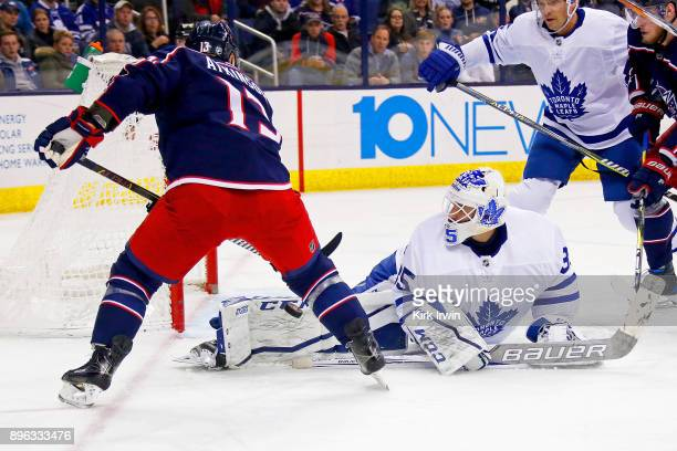 Curtis McElhinney of the Toronto Maple Leafs stops a shot from Cam Atkinson of the Columbus Blue Jackets during the second period on December 20 2017...