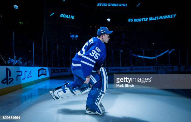 Curtis McElhinney of the Toronto Maple Leafs takes the ice during player introductions during opening night before play against the New York Rangers...