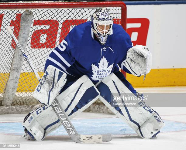 Curtis McElhinney of the Toronto Maple Leafs warms up prior to playing against the Montreal Canadiens in an NHL game at the Air Canada Centre on...