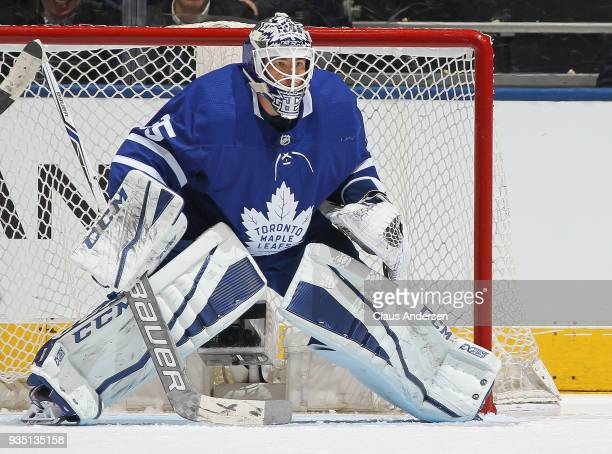 Curtis McElhinney of the Toronto Maple Leafs watches for a shot against the Montreal Canadiens during an NHL game at the Air Canada Centre on March...