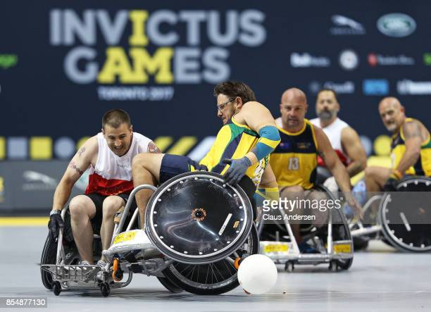 Curtis McGrath of Team Australia loses control in action against Team Canada on Day Five at Wheelchair Rugby during the 2017 Invictus Games at...