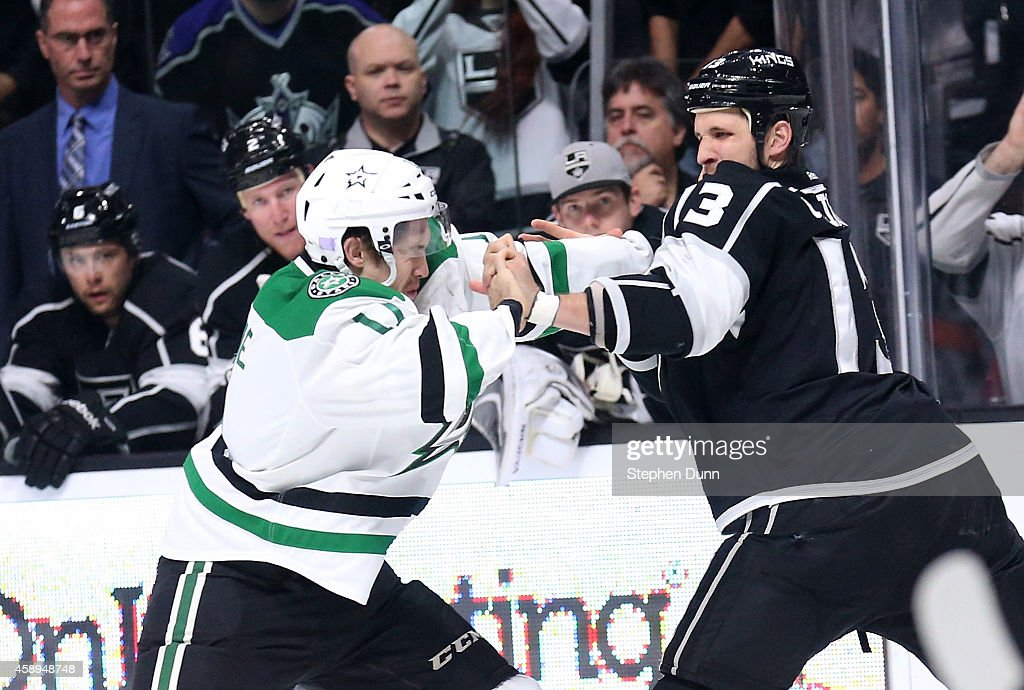 Curtis McKenzie #11 of the Dallas Stars and Kyle Clifford #13 of the Los Angeles Kings fight at Staples Center on November 13, 2014 in Los Angeles, California.