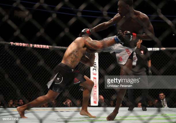 Curtis Millender kicks Max Griffin in their welterweight fight during the UFC 226 event inside TMobile Arena on July 7 2018 in Las Vegas Nevada