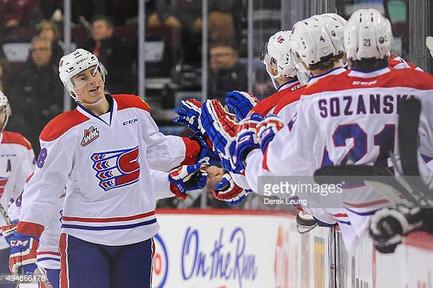 Curtis Miske of the Spokane Chiefs celebrates with the bench after scoring against the Calgary Hitmen during a WHL game at Scotiabank Saddledome on...