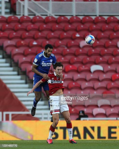 Curtis Nelson of Cardiff City contests a header with Dael Fry of Middlesbrough during the Sky Bet Championship match between Middlesbrough and...