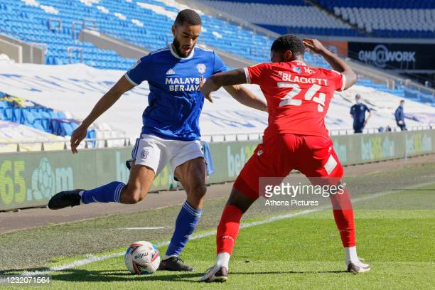 Curtis Nelson of Cardiff City is closely marked by Tyler Blackett of Nottingham Forest during the Sky Bet Championship match between Cardiff City and...