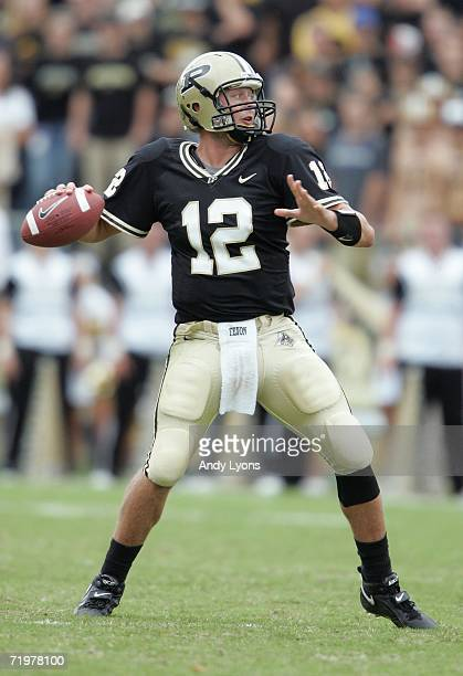 Curtis Painter of the Purdue Boilermakers gets set to throw a pass against the Minnesota Golden Gophers during a Big Ten Conference game September 23...