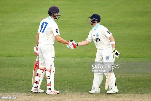 Curtis Patterson and Steve Smith of the Blues celebrate their celebrates his century run partnership during day three of the Sheffield Shield match...