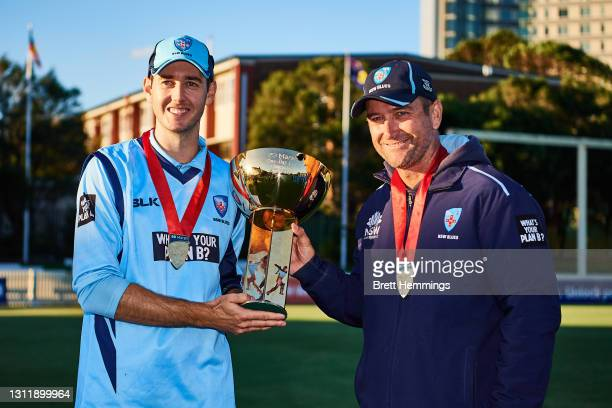 Curtis Patterson of NSW and Coach Phil Jaques pose for a photo with the tropy during the 2021 Marsh One Day Cup Final match between New South Wales...