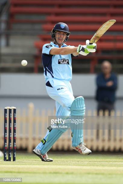Curtis Patterson of the NSW Blues celebrates with his team mates after taking the catch to dismiss Simon Milenko of the Tigers during the JLT One Day...