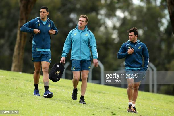 Curtis Rona Dane HaylettPetty and Nick Phipps arrive during an Australian Wallabies training session at McGillivray Oval on September 4 2017 in Perth...