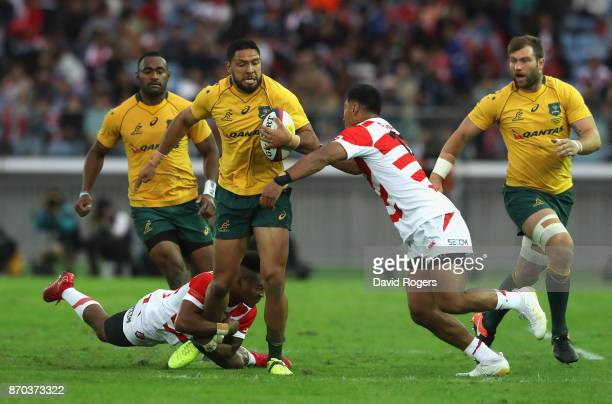 Curtis Rona of Australia is tackled during the rugby union international match between Japan and Australia Wallabies at Nissan Stadium on November 4...