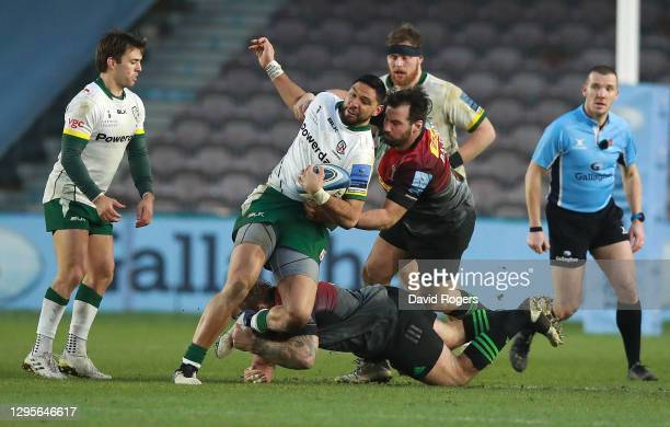 Curtis Rona of London Irish is tackled by Joe Marler and Scott Baldwin during the Gallagher Premiership Rugby match between Harlequins and London...