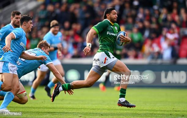 Curtis Rona of London Irish is tap tackled by Freddie Clarke of Gloucester during the Gallagher Premiership Rugby match between London Irish and...