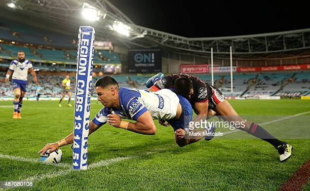 Curtis Rona of the Bulldogs scores a try during the round 26 NRL match between the Canterbury Bulldogs and the New Zealand Warriors at ANZ Stadium on...