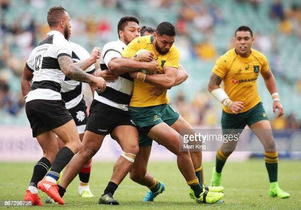 Curtis Rona of the Wallabies is tackled during the match between the Australian Wallabies and the Barbarians at Allianz Stadium on October 28 2017 in...