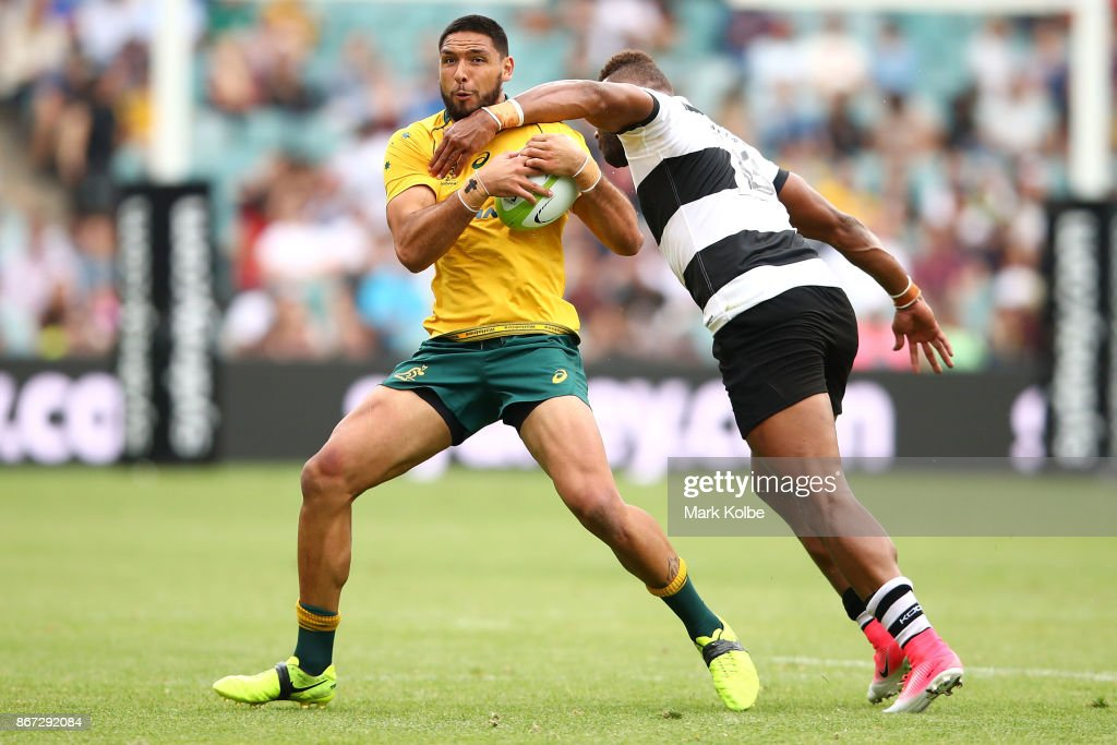 Curtis Rona of the Wallabies is tackled Thomas Banks of the Barbarians during the match between the Australian Wallabies and the Barbarians at Allianz Stadium on October 28, 2017 in Sydney, Australia.