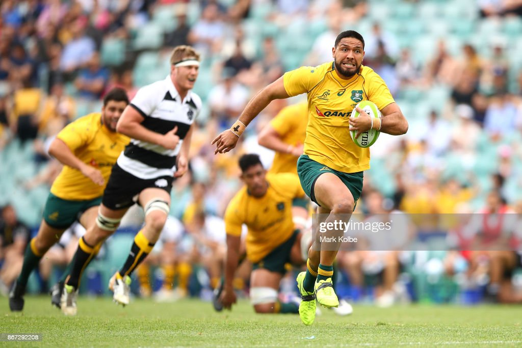 Curtis Rona of the Wallabies makes a break during the match between the Australian Wallabies and the Barbarians at Allianz Stadium on October 28, 2017 in Sydney, Australia.