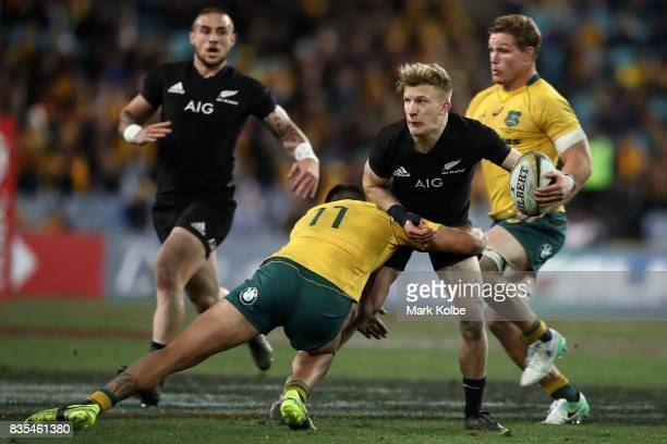 Curtis Rona of the Wallabies tackles Damian McKenzie of the All Blacks during The Rugby Championship Bledisloe Cup match between the Australian...