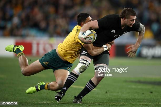 Curtis Rona of the Wallabies tackles Liam Squire of the All Blacks during The Rugby Championship Bledisloe Cup match between the Australian Wallabies...