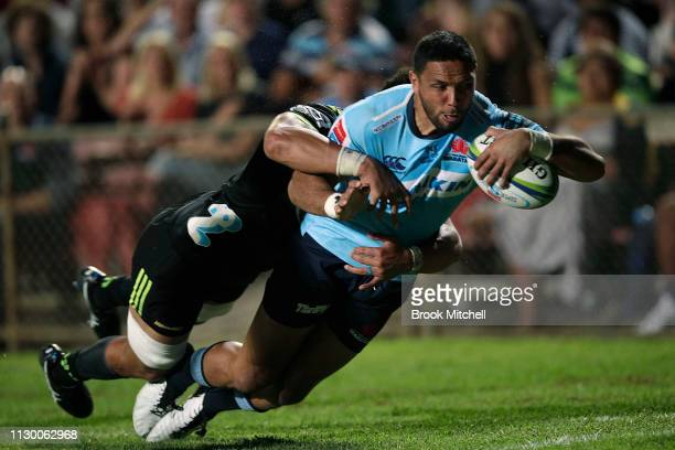 Curtis Rona of the Waratahs dives to score a try during the round one Super Rugby match between the Waratahs and the Hurricanes at Brookvale Oval on...