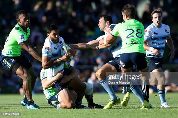 Curtis Rona of the Waratahs is tackled during the preseason Super Rugby match between the Highlanders and the Waratahs on February 01 2019 in...