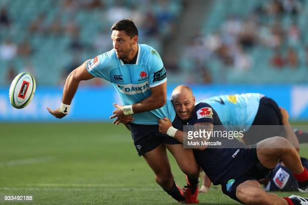 Curtis Rona of the Waratahs offloads during the round five Super Rugby match between the Waratahs and the Rebels at Allianz Stadium on March 18 2018...