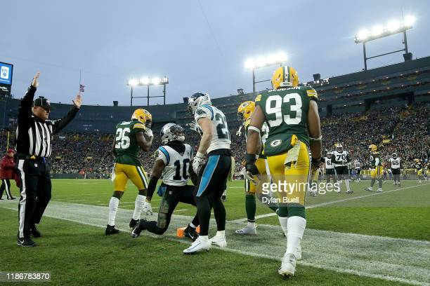 Curtis Samuel of the Carolina Panthers celebrates with Christian McCaffrey after scoring a 2 yard touchdown pass against the Green Bay Packers during...