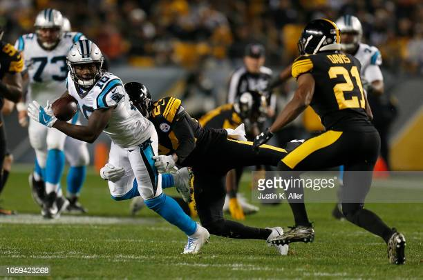 Curtis Samuel of the Carolina Panthers is wrapped up for a tackle by Coty Sensabaugh of the Pittsburgh Steelers during the first half in the game at...