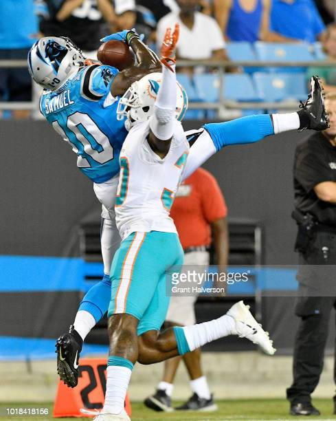 Curtis Samuel of the Carolina Panthers jumps for a catch against Cordrea Tankersley of the Miami Dolphins in the third quarter during the game at...