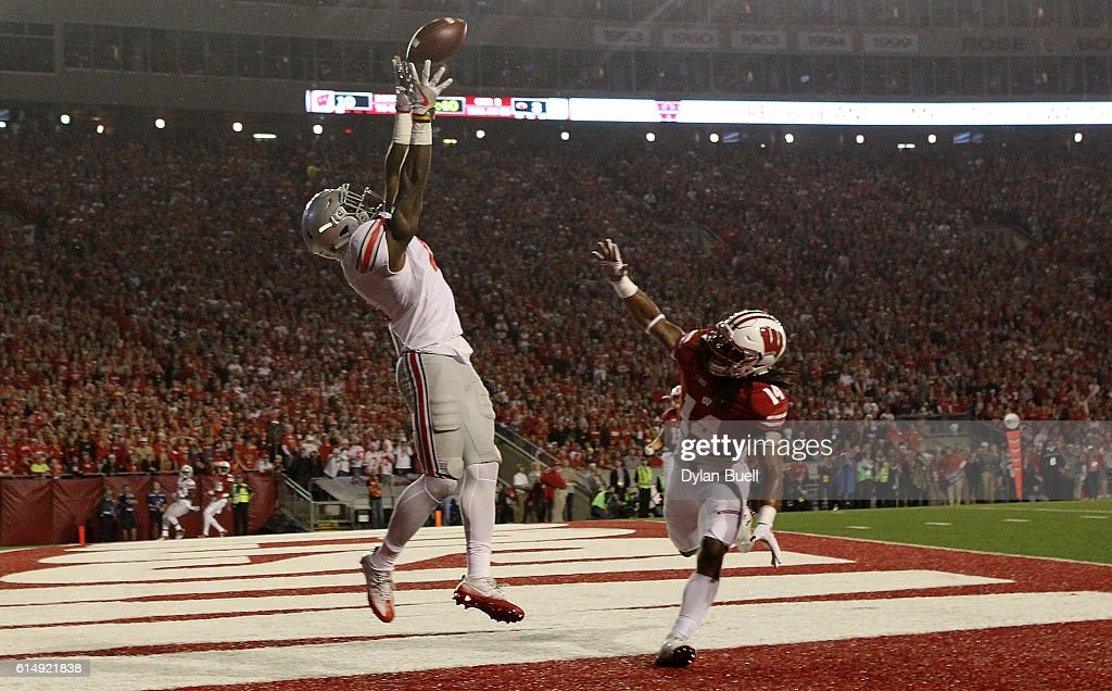 Curtis Samuel #4 of the Ohio State Buckeyes fails to make a catch while being guarded by D'Cota Dixon #14 of the Wisconsin Badgers in the second quarter at Camp Randall Stadium on October 15, 2016 in Madison, Wisconsin.