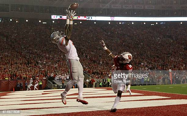 Curtis Samuel of the Ohio State Buckeyes fails to make a catch while being guarded by D'Cota Dixon of the Wisconsin Badgers in the second quarter at...