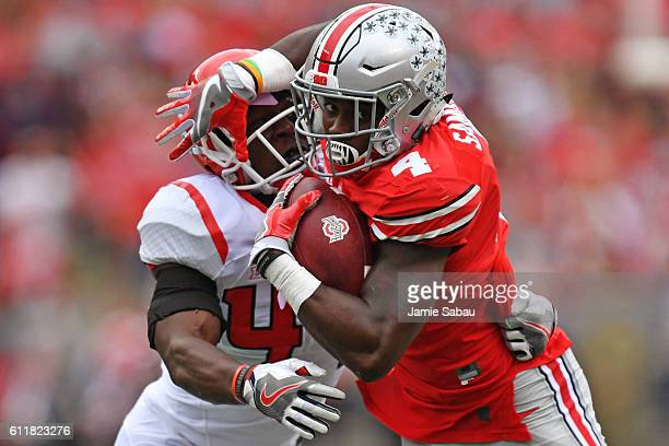Curtis Samuel of the Ohio State Buckeyes fights off a tackle attempt from Tyreek MaddoxWilliams of the Rutgers Scarlet Knights in the second quarter...