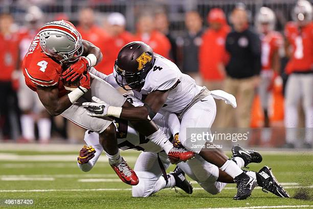 Curtis Samuel of the Ohio State Buckeyes is brought down by Antonio Shenault of the Minnesota Golden Gophers and Adekunle Ayinde of the Minnesota...