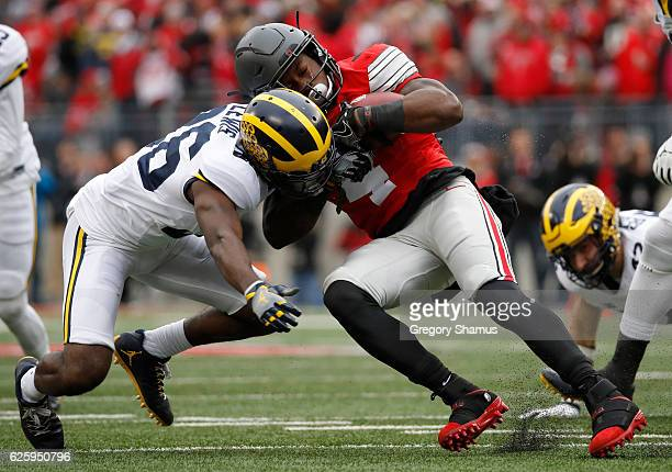 Curtis Samuel of the Ohio State Buckeyes is tackled by Jourdan Lewis of the Michigan Wolverines during the first half of their game at Ohio Stadium...