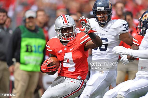 Curtis Samuel of the Ohio State Buckeyes looks for running room in the fourth quarter against the Kent State Golden Flashes at Ohio Stadium on...