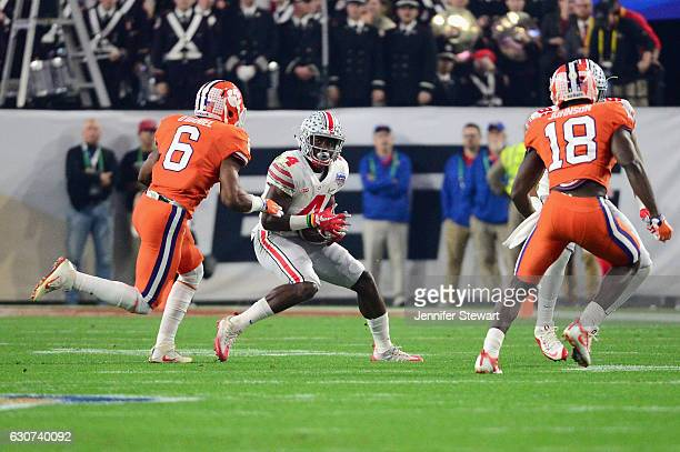 Curtis Samuel of the Ohio State Buckeyes past Dorian O'Daniel of the Clemson Tigers during the first half of the 2016 PlayStation Fiesta Bowl at...