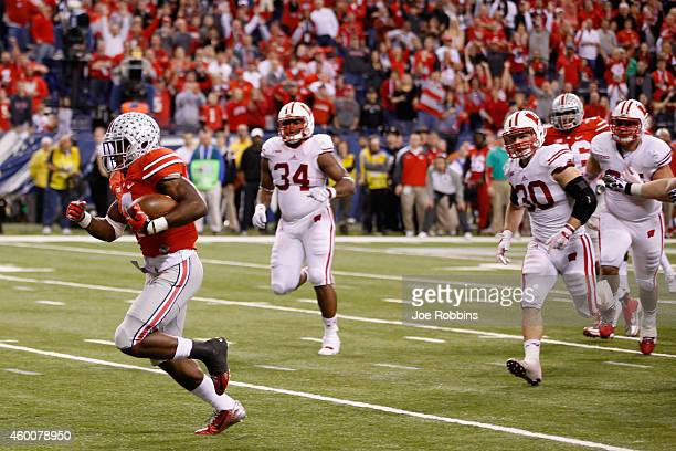 Curtis Samuel of the Ohio State Buckeyes runs in for a touchdown in the fourth quarter against the Wisconsin Badgers in the Big Ten Championship at...